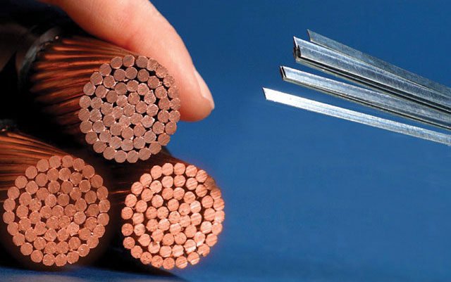 American Superconductor's Amperium™ wire conducts more than 100 times the electrical current of equivalent sized copper wire. As a result, the few Amperium wires pictured on the right are able to carry as much power as all of the copper on the left. (Courtesy of American Superconductor)